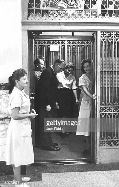 CUSTOMER The gentleman in the photo above isn't so intent on his manners that he's bowing to elevator operator Mrs Naomi Yakish 140 S Garland St but...