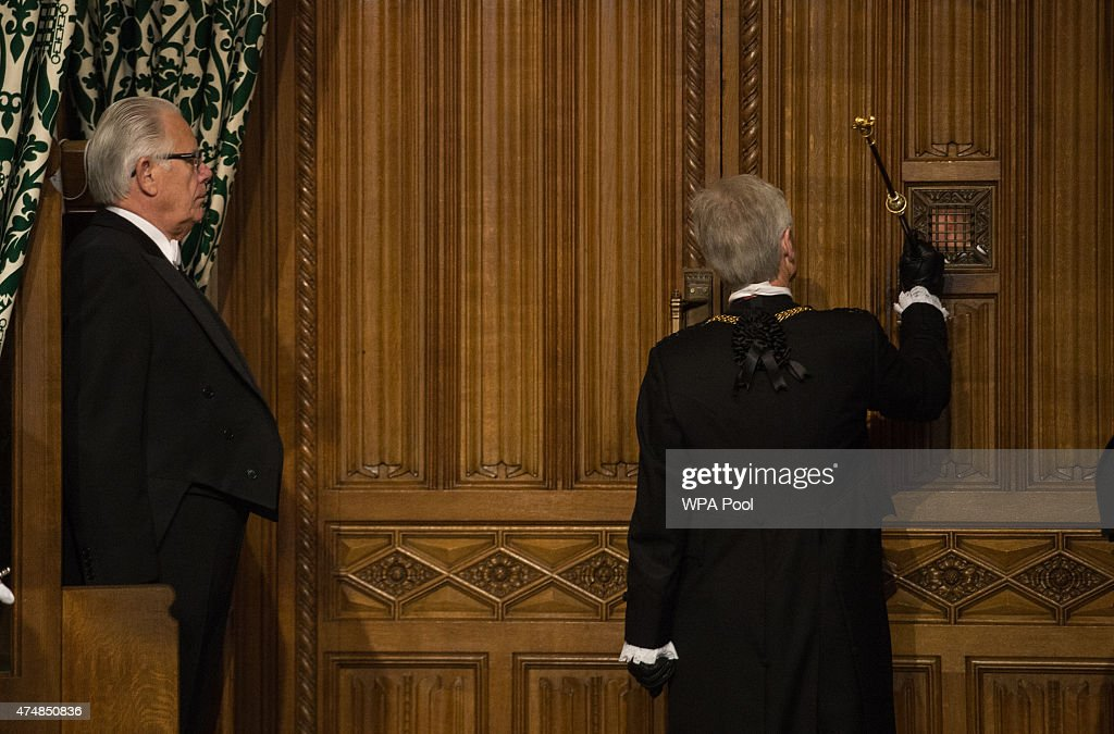 The Gentleman Usher of the Black Rod David Leakey knocks on the door to the House of Commons in the Members' Lobby before the Queen's Speech at the...