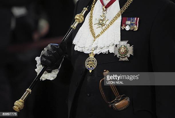The Gentleman Usher of the Black Rod stands at the entrance to the the House of Lords ahead of the State Opening of Parliament in London on December...
