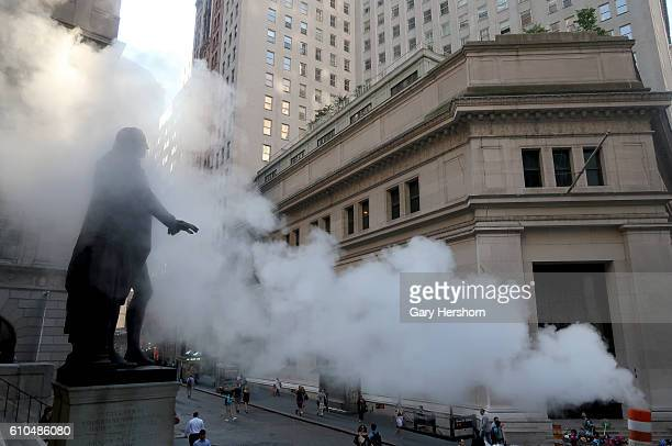 The George Washington Statue in front of Federal Hall on Wall street is engulfed in a cloud of steam on September 23 2016 in New York City