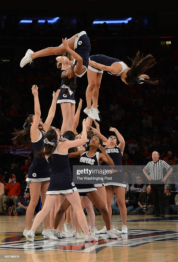The Georgetown Hoya cheerleaders perform during the second half of their Semifinal Round game of the Big East Championship at Madison Square Garden on Friday, March 15, 2013. The Georgetown Hoyas lost to the Syracuse Orange 58-55 in overtime.