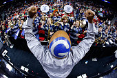 The Georgetown Hoyas band performs as their conductor directs with a painted 'G' on his head at halftime against the Eastern Washington Eagles during...