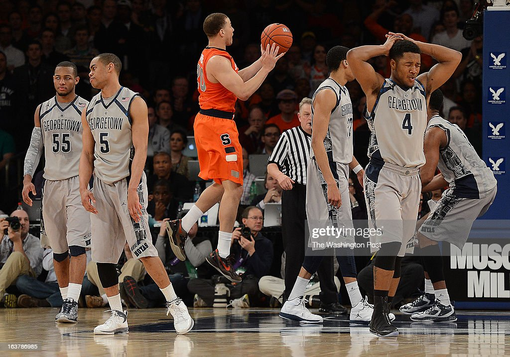 The Georgetown Hoyas reacts after Georgetown Hoyas guard Markel Starks (5) is called for his final foul of the game against Syracuse Orange guard Brandon Triche (20) during overtime of the Semifinal Round game of the Big East Championship at Madison Square Garden on Friday, March 15, 2013. The Georgetown Hoyas lost to the Syracuse Orange 58-55 in overtime.