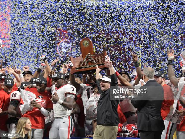 The Georgia Bulldogs celebrate after winning SEC Championship game between the Georgia Bulldogs and the Auburn Tigers on December 02 at MercedesBenz...