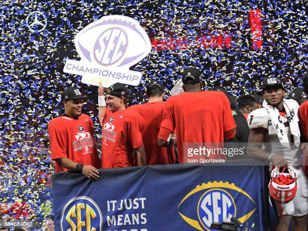 The Georgia Bulldogs celebrate after winning the SEC Championship game between the Georgia Bulldogs and the Auburn Tigers on December 02 at...