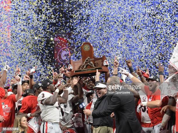 The Georgia Bulldogs celebrate winning the SEC Championship game between the Georgia Bulldogs and the Auburn Tigers on December 02 at MercedesBenz...