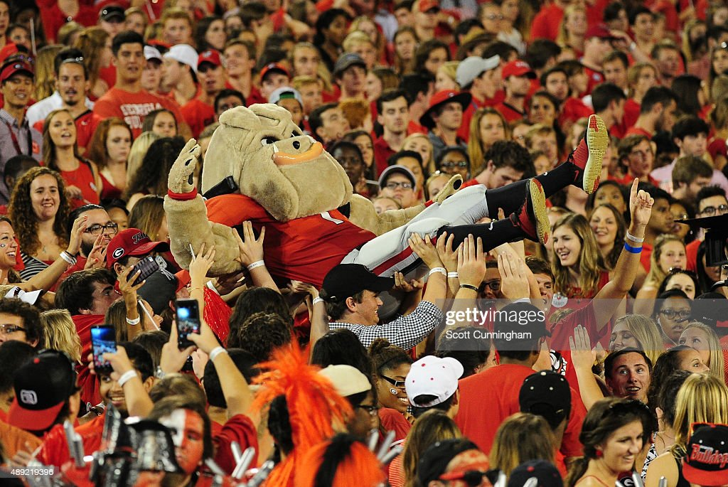 The georgia bulldogs mascot hairy dog goes crowd surfing during the