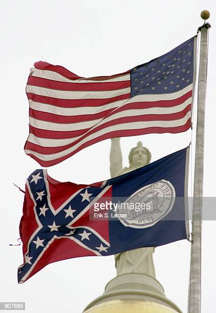 The Georgia state flag flies underneath the American Flag January 7 2001 at the Georgia State Capitol in Atlanta GA US Rep John Lewis confirmed...