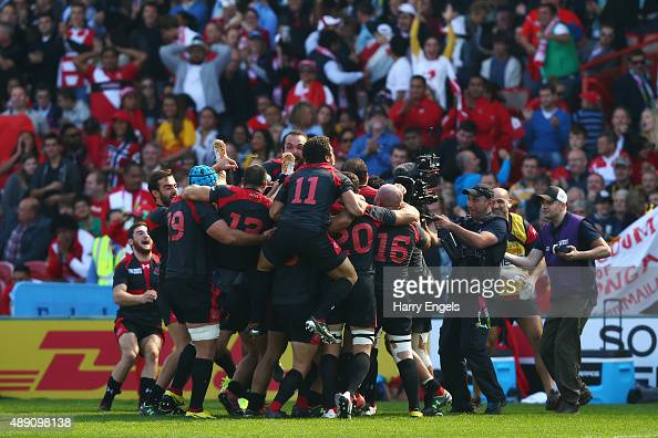The Georgia team celebrate at the final whistle during the 2015 Rugby World Cup Pool C match between Tonga and Georgia at Kingsholm Stadium on...