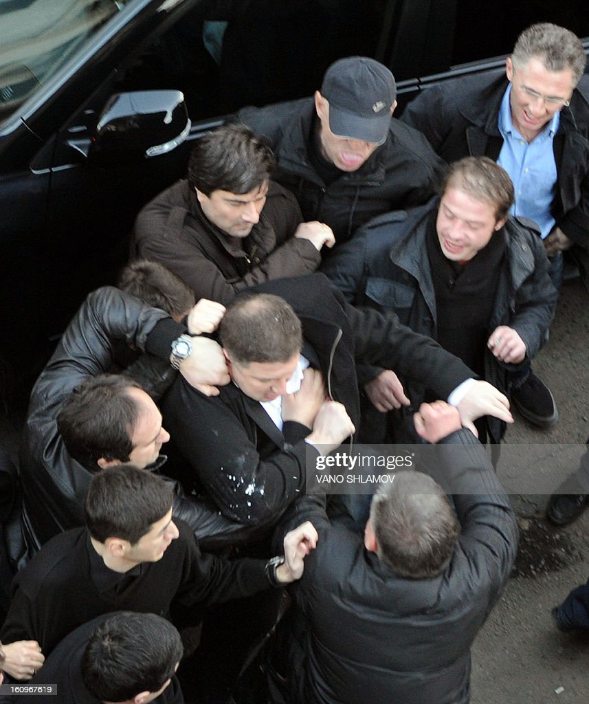 The Georgian capital Tbilisi mayor, Gigi Ugulava (C), scuffles with protesters in Tbilisi , on February 8, 2013. An angry crowd of around 300 protesters aimed today punches and kicks at the mayor of Tbilisi and several lawmakers from President Mikheil Saakashvili's party in the Georgian capital, hours before the president was to give his annual state of the nation address.