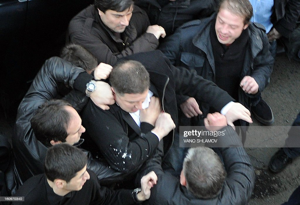 The Georgian capital Tbilisi mayor, Gigi Ugulava (C), scuffles with protesters in Tbilisi , on February 8, 2013. An angry crowd of around 300 protesters aimed today punches and kicks at the mayor of Tbilisi and several lawmakers from President Mikheil Saakashvili's party in the Georgian capital, hours before the president was to give his annual state of the nation address. AFP PHOTO / VANO SHLAMOV