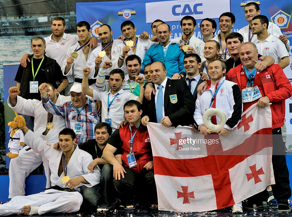 The Georgian gold medal winning men's team and coaching staff enjoy the moment at the Budapest European Team Championships held at the Papp Laszlo Sports Hall, on April 28, 2013 Budapest, Hungary.