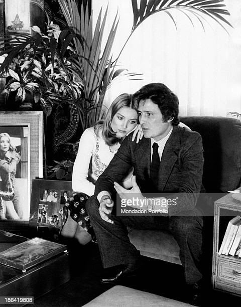The German actress Barbara Bouchet embraces her husband Luigi Borghese a movie producer she married last year they're seated in the living room of...