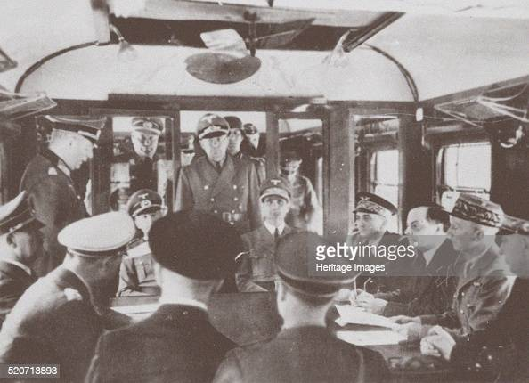 The German and French delegations inside a railroad car at Compiègne for the signing of France's surrender to Germany June 1940 Found in the...
