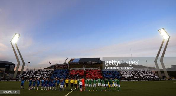 The German and the Faroer team stand for the national anthems prior to the FIFA World Cup 2014 qualifying football match Faroe Island vs Germany in...