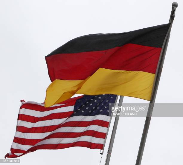 The German and the US flags fly at the US Airbase in Ramstein southern Germany on November 6 2013 The German government is to study whether US...