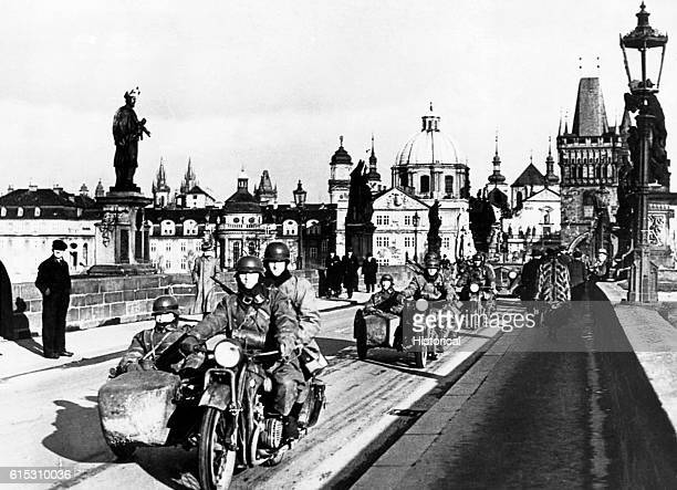 The German Army enters Prague with a procession of motorcycles in March 1939 several months prior to the commencement of the European War