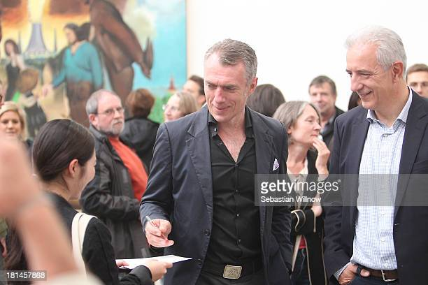 The German artist Neo Rauch and German state Saxony prime minister Stanislaw Tillich during the Autumn Gallery Tour in the art gallery 'EigenArt' at...