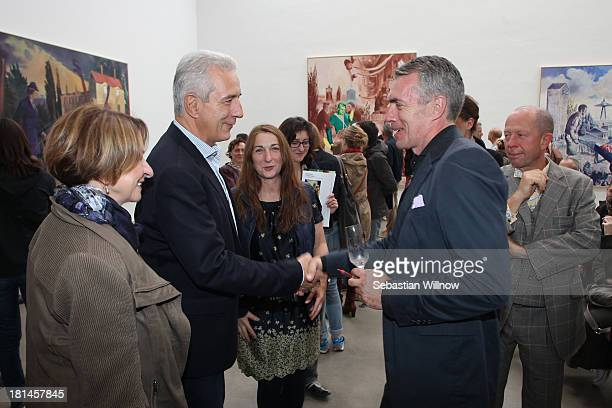 The German artist Neo Rauch welcomes German state Saxony prime minister Stanislaw Tillich during the Autumn Gallery Tour in the art gallery...