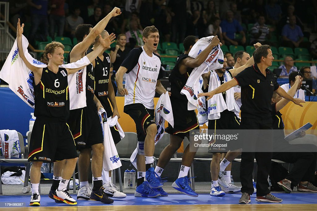 The German bench with (L-R) Per Guenther and Andreas Seiferth celebrates during the FIBA European Championships 2013 first round group A match between France and Germany at Tivoli Arena on September 4, 2013 in Ljubljana, Slovenia. The match betweenFrance and Germany ended 74-80.