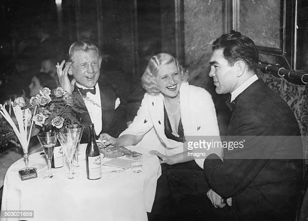 The German boxer Max Schmeling and Hans Breitensträter with singer Lee Parry at the Palais de Danse at a charity event 16th December 1932 Photograph