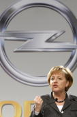 The German Chancellor Angela Merkel speaks during a visit at the Opel headquarters on March 31 2009 in Ruesselsheim Germany The German carmaker Opel...