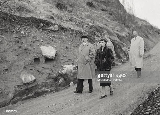 The German Chancellor Konrad Adenauer walking on holiday with one of his daughters and with his confidential secretary Ascona 1956
