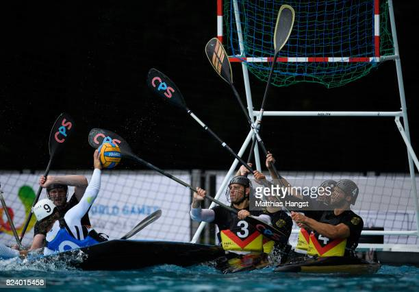 The German defence block a shot during the Canoe Polo Men's match between Italy and Germany of The World Games at Orbita Outdoor Swimming Pool on...