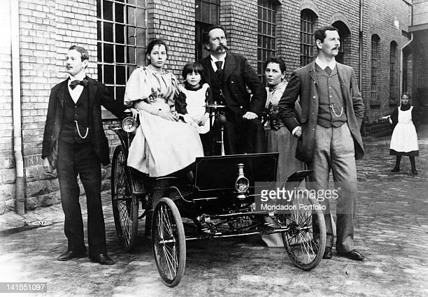 The German engineer Karl Benz posing aboard a quad with sons Richard Thilde Ellen Clara and Eugene