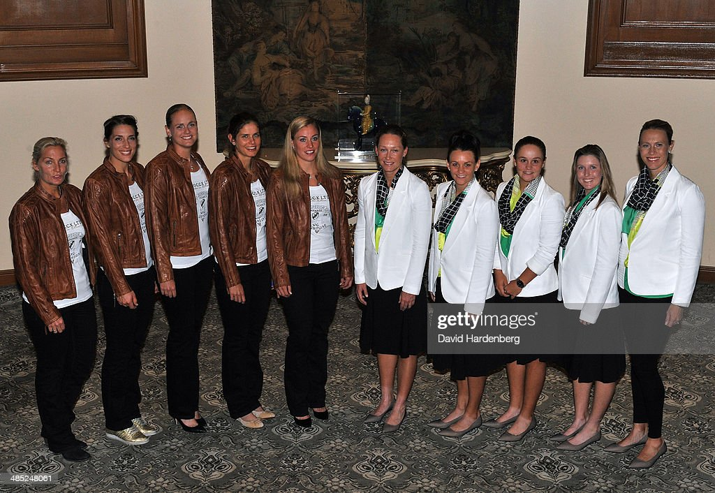 The German Fed Cup team (L-R) Coach <a gi-track='captionPersonalityLinkClicked' href=/galleries/search?phrase=Barbara+Rittner&family=editorial&specificpeople=220349 ng-click='$event.stopPropagation()'>Barbara Rittner</a>, Anna Petkovic, <a gi-track='captionPersonalityLinkClicked' href=/galleries/search?phrase=Anna-Lena+Groenefeld&family=editorial&specificpeople=193798 ng-click='$event.stopPropagation()'>Anna-Lena Groenefeld</a>, <a gi-track='captionPersonalityLinkClicked' href=/galleries/search?phrase=Julia+Goerges&family=editorial&specificpeople=4474037 ng-click='$event.stopPropagation()'>Julia Goerges</a> and <a gi-track='captionPersonalityLinkClicked' href=/galleries/search?phrase=Angelique+Kerber&family=editorial&specificpeople=4307332 ng-click='$event.stopPropagation()'>Angelique Kerber</a> and the Australian Federation Cup Team (L-R) <a gi-track='captionPersonalityLinkClicked' href=/galleries/search?phrase=Samantha+Stosur&family=editorial&specificpeople=194778 ng-click='$event.stopPropagation()'>Samantha Stosur</a>, <a gi-track='captionPersonalityLinkClicked' href=/galleries/search?phrase=Casey+Dellacqua&family=editorial&specificpeople=575797 ng-click='$event.stopPropagation()'>Casey Dellacqua</a>, <a gi-track='captionPersonalityLinkClicked' href=/galleries/search?phrase=Ashleigh+Barty&family=editorial&specificpeople=7369424 ng-click='$event.stopPropagation()'>Ashleigh Barty</a> and Storm Sanders pose for a photo during the Fed Cup official dinner ahead of the Semi Final tie between Australia and Germany at the Stamford Plaza on April 17, 2014 in Brisbane, Australia.