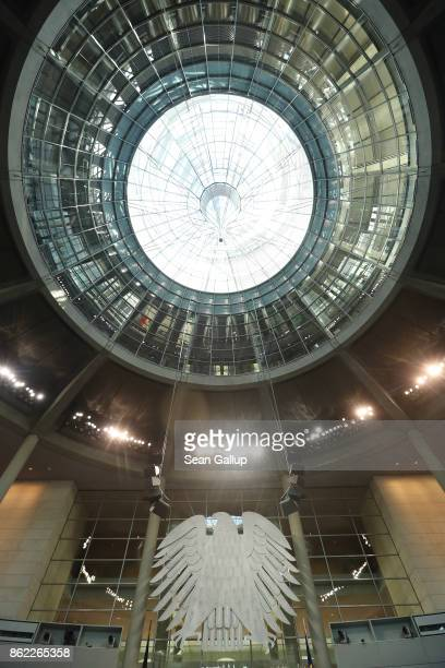 The German Federal Eagle hangs under the cupola in the Bundestag at the Reichstag on October 17 2017 in Berlin Germany Following German federal...