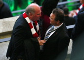 The German Federal Minister of the Interior HansPeter Friedrich talks to Uli Hoeness President of Bayern Muenchen prior to the DFB Cup Final match...