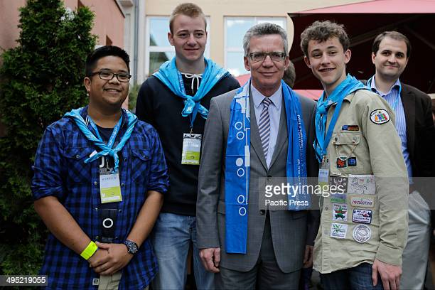 REGENSBURG BAVARIA GERMANY The German Federal Minister of the Interior Thomas de Maiziere poses for the camera with a group of Boy Scouts who...