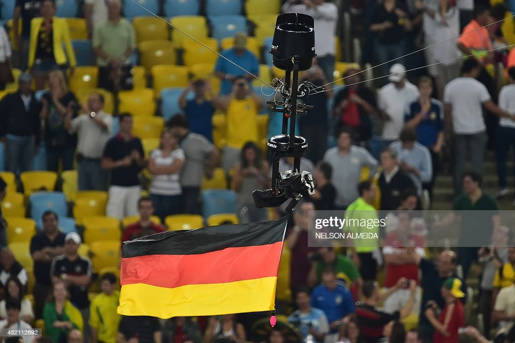 The German flag flies from a 'spidercam ' above the pitch after the final football match between Germany and Argentina for the FIFA World Cup at The...