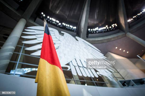 The German Flag is pictured in front of the Federal Eagle at the Reichstag on October 17 2017 in Berlin Germany Following German federal elections...