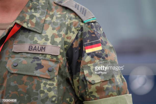 The German flag is seen on the uniform of a soldier on 22 June 2017