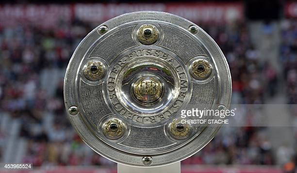 The German football championship trophy is pictured ahead of the German first division Bundesliga football match FC Bayern Munich vs VfL Wolfsburg at...