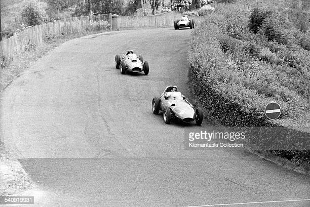 The German Grand Prix Nürburgring August 3 1958 Near the end Tony Brooks leads the Ferraris of Peter Collins and Mike Hawthorn over Adenau Bridge and...