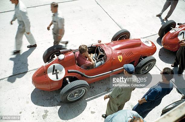The German Grand Prix Nürburgring August 3 1958 Wolfgang Amon Trips covers hs ears as he warms up his Ferrari 246/F1 before practice