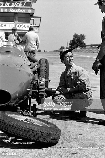 The German Grand Prix Nürburgring August 4 1957 A pit scene during practice as a Maserati mechanic works on a Maserati 250F suspension