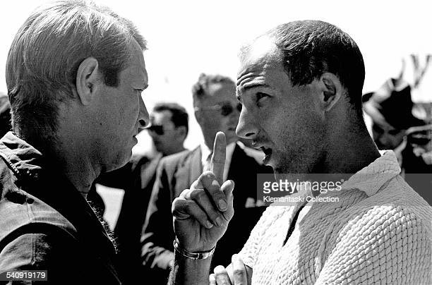 The German Grand Prix Nürburgring August 4 1957 Always with strong opinions Stirling Moss makes his point to Peter Collins Moss finished fifth with...