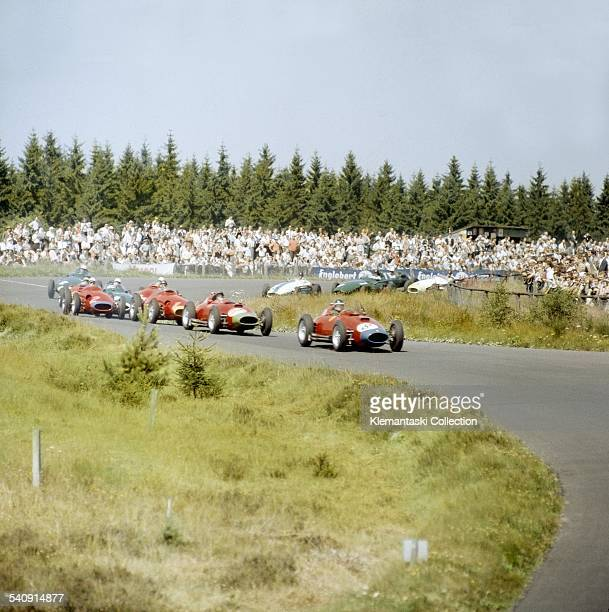 The German Grand Prix Nürburgring August 4 1957 Just after the start Mike Hawthorn and Peter Collins with their Ferraris lead Juan Manuel Fangio's...