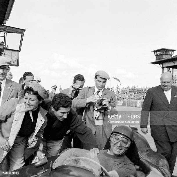 The German Grand Prix Nürburgring August 5 1956 Juan Manuel Fangio arrives at the winner's circle and receives the congratulations of his lady friend...