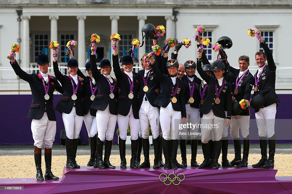 The German, Great Britain and New Zealand teams celebrate on the podium after being presented with their respective Gold, Silver and Bronze Medals in the Eventing Team Jumping Final Equestrian event on Day 4 of the London 2012 Olympic Games at Greenwich Park on July 31, 2012 in London, England.