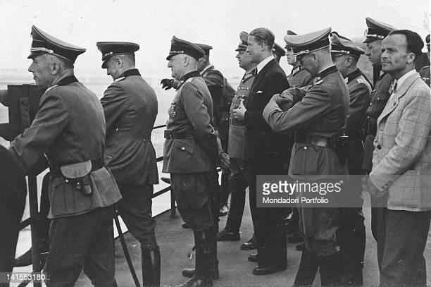 The German inventor of the V2 missiles Wernher von Braun watching the launch of the missile with Field Marshal Walther von Brauchitsch Peenemunde May...