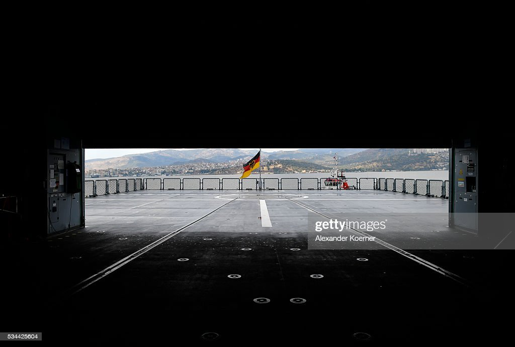 The German national flag is seen through a hangar of th combat support ship ãBonnÒ while docked at the port of Izmir on May 26, 2016 in Izmir, Turkey. NATO's Standing Maritime Group 2 is currently deployed in the region between the mainland of Greece and Turkey, and will conduct surveillance and monitor illegal crossings in the Aegean Sea. The number of attempts by refugees to reach the islands of Greece has dropped rapidly.