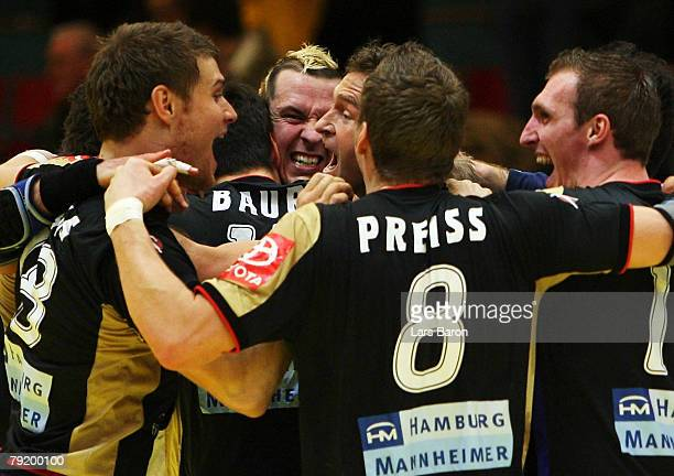 The german players celebrate after winning the Men's Handball European Championship main round Group II match between Germany and Sweden at Trondheim...