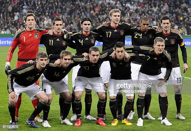 The German players pose for the team photo before the friendly football match Germany vs Argentina in the southern German city of Munich on March 3...