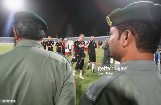 The German team and arab police officer are seen during a Germany training session at the AlMaktoum Stadium on May 31 2009 in Dubai United Arab...