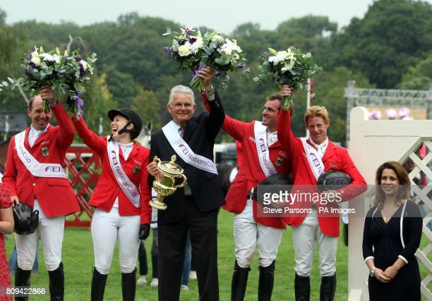 The German team celebrate Philipp Weishaupt JanneFriederike Meyer Holger Wulschner and Marcus Ehning after winning the Nations cup with FEI President...